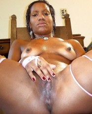Sexy black girl spreading pussy on camera